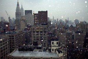cityscape_view_of_buildings_with_snow_falling