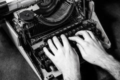 hands-writing-old-typewriter-monochrome-64579388